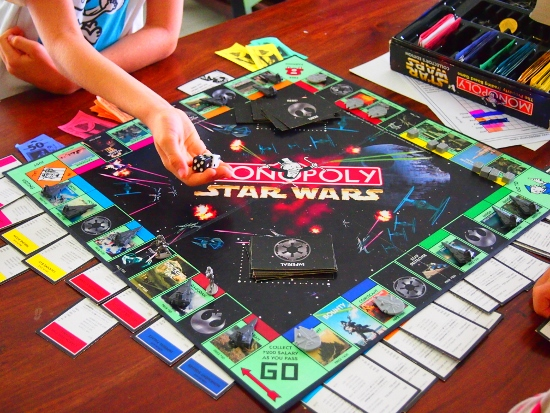 Kids Using Monopoly as a Homeschooling Resource