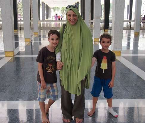 Teaching kids about Islam. Non Muslim family visiting a mosque